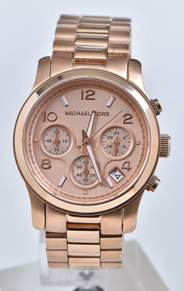 bef5b31ebcf MICHAEL KORS. Relógio americano feminino de pulso com cronógrafo e  calendário da marca