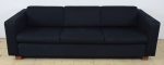 """Sofá para 3 lugares design """"Janete Costa"""" com forração em tecido negro. Comp.: 2,20m."""