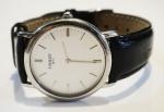 """TISSOT. Relógio unissex suíço de pulso da marca """"Tissot"""". Caixa em aço. Movimento à quartz. Diam. do visor: 3,0cm. (Funcionando)."""