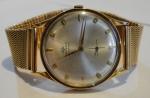 """MOVADO. Relógio masculino suíço de pulso automático da marca """"Movado"""" (Década de 60). Caixa e pulseira em ouro 18k. Diam. do mostrador: 3,2cm. Peso: 62,2. Funcionando."""